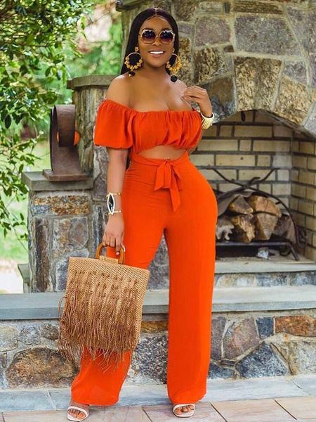 Image of Tuta arancione per donna senza spalline maniche corte con lacci aperti senza spalline in poliestere tuta corta estiva