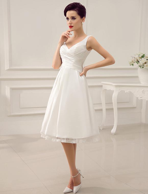 Robe de mariage ivoire mi longues bretelles dos nu for Meilleurs concepteurs de robe de mariage de plage