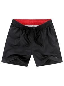 Image of -Pantaloncini da bagno nero con coulisse in vita estate spiaggia