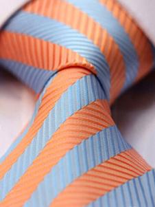 Image of Cravatta abito formale a strisce arancio fluorescente di poliestere