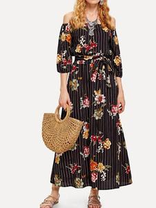 Image of Abito lungo nero con stampa floreale a fascia lunga con stampa f