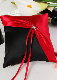 red-metal-bows-ribbons-satin-wedding-pillow