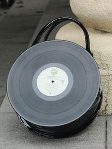 glossy-black-loltia-handbag-round-record-shape